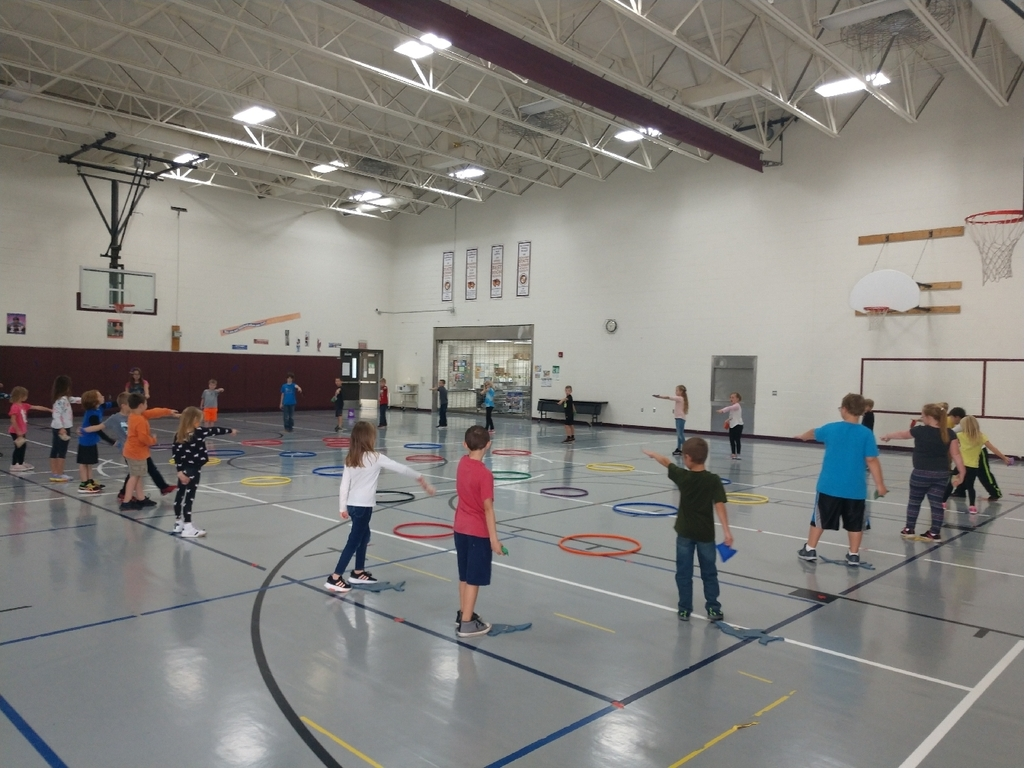 1st and 2nd graders worked on underhand throw and locomotor skills today in PE.
