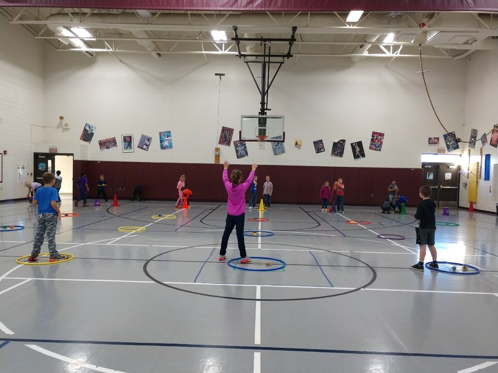 "3rd graders participated in a new game today ""collect the treasure"". Students were able to work on overhand throwing and catching skills while choosing which size ball to throw and how far to pass it."