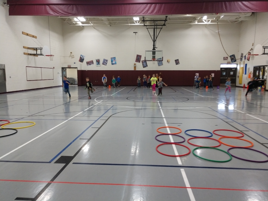 First, second, and third grade students excersied their bodies and their brain today participating in fitness tic tac toe today in PE.